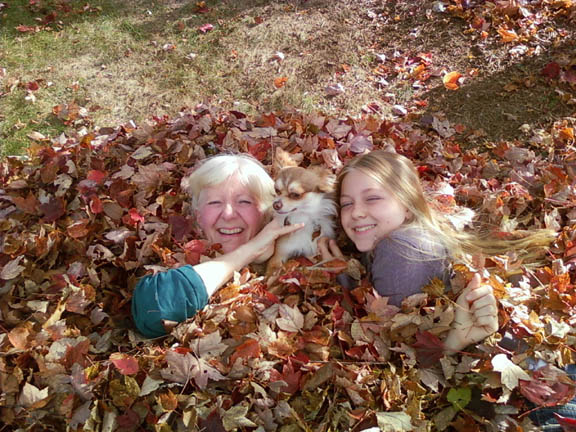 Kathleen & Kyra with dog Weeness in leaves